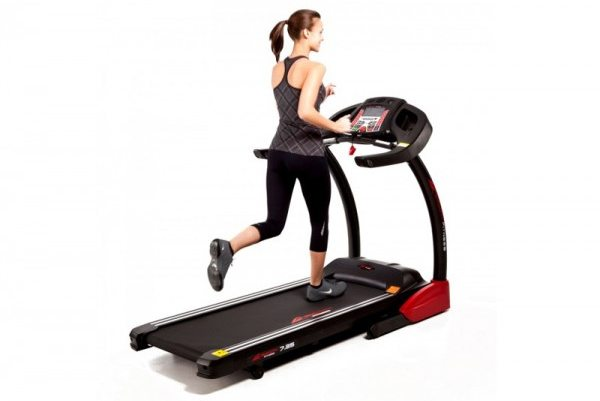 woman running on treadmill at cardio center amenity at Monterey Bay